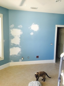 blue bedroom wall before painting